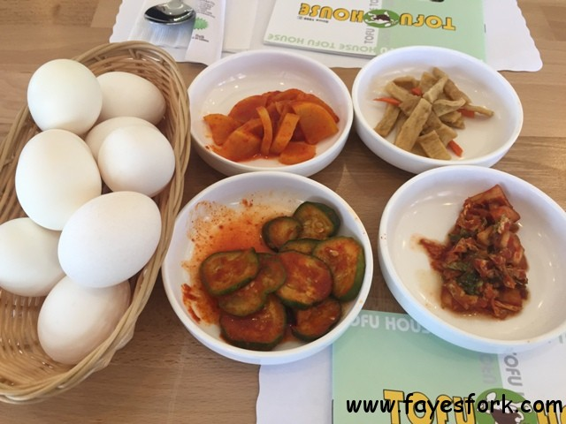 Banchan and raw eggs on each table