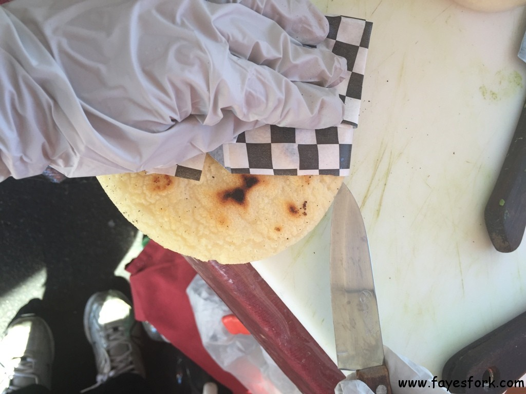 SLICING OPEN THE PIPING HOT AREPA